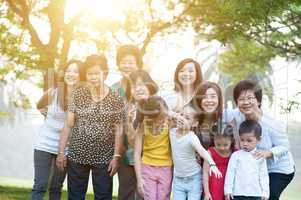 Large group of Asian multi generations family outdoors