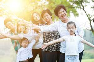 Big group of Asian multi generations family outdoors fun