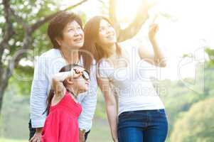Grandmother, mother and daughter exploring outdoor.
