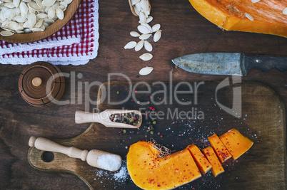 piece of fresh pumpkin with salt and pepper