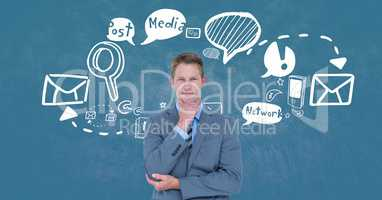 Thought businessman standing by various icons against blue background