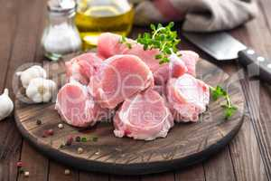 Raw meat, fillet, tenderloin on wooden background