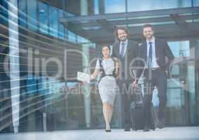 Three business people with luggage and arrow graphic overlay