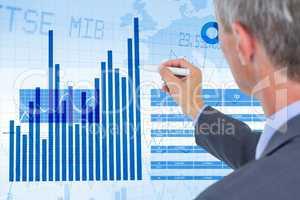 Businessman analyzing graph on screen