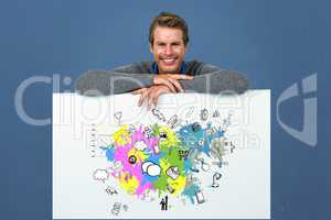 Happy man leaning on placard with social media icons