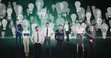 Digital composite image of business people over light bulb background