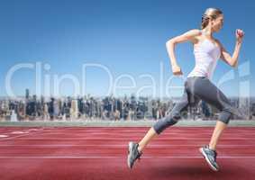 Female runner going on track against skyline