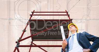 Architect under 3D scaffolding with  bricks background