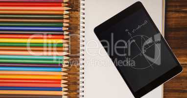 Tablet PC with diagram by colored pencils