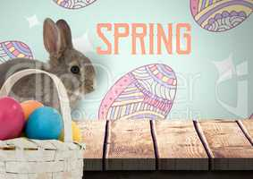 Spring text with rabbit with eggs basket in front of pattern