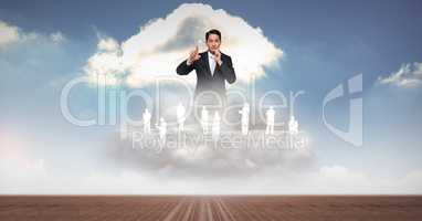 Digitally generated image of businessman with employees on clouds