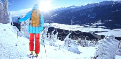 Composite image of skier with backpack on snowy field