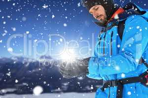 Composite image of skier with backpack wearing gloves