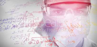 Composite image of doctor in protective glasses and surgical mask holding electronic chip