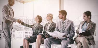 Businessman welcoming people waiting for interview
