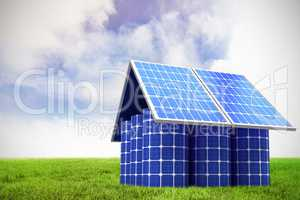 Composite image of 3d image of model home made from solar panels and cells