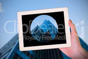 Composite image of feminine hand holding tablet