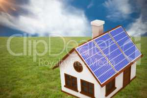 Composite image of 3d image of house with solar panels