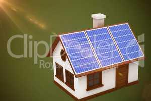 Composite image of digitally generated image of 3d house with solar panels