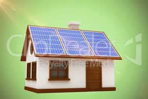 Composite image of 3d illustration of house with solar panels