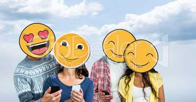 Men and women with mobile phones and emojis over face