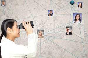 Businesswoman looking at candidates through binoculars