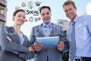 Happy business people with digital tablet and social media icons