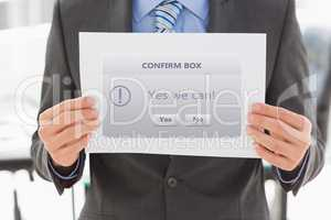 Digital composite image of businessman holding confirm box