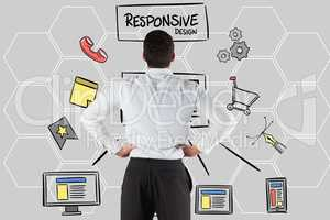Rear view of businessman looking at responsive design text and icons