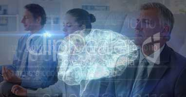 Multiple exposure of business people meditating with brain in foreground