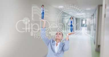 Digital composite image of businesswoman holding executives in hands with symbols