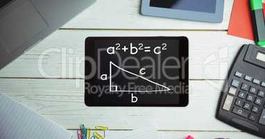 Directly above shot of formula in smart phone with technologies and office supplies on wooden table