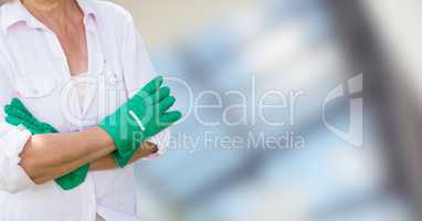 Gardener with her hands folded on blurred background