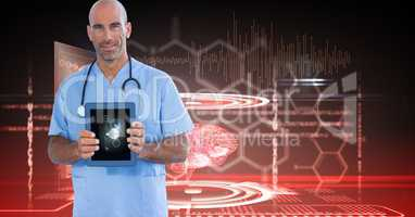 Digitally generated image of male doctor showing digital tablet against tech graphics
