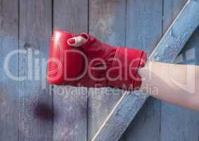 Right hand female in a red boxing glove