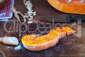 piece of ripe pumpkin in salt and pepper