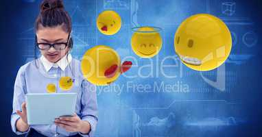 Digitally generated image of woman using tablet computer with emojis flying against tech graphics in