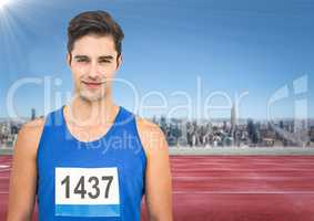 Male runner with number on shirt on track against skyline