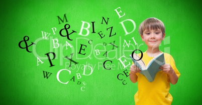 Digitally generated image of boy holding books with letters flying against green background