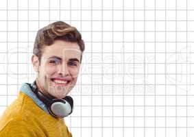 Happy man with headphones on grid background