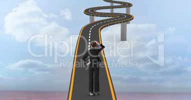 Digital composite image of confused businesswoman on curvy bridge