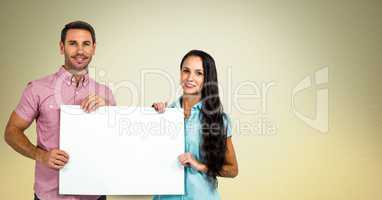 Smiling couple holding blank billboard