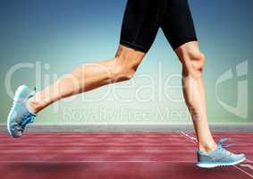 Runner legs on track against blue green background