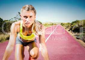 Woman runner on track in desert