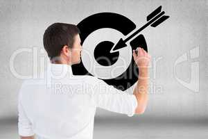 Digitally generated image of man drawing target icon against gray background