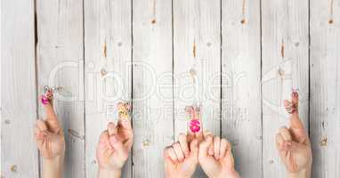Fingers with rabbits with wood background. happy Easter.