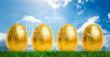 Gold Easter Eggs in front of blue sky