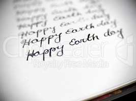 Happy earth day calligraphy and lattering.