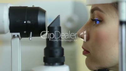 Woman examining eyesight in ophthalmology clinic