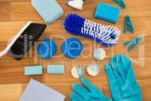 HIgh angle view of gloves and brush with clothespin